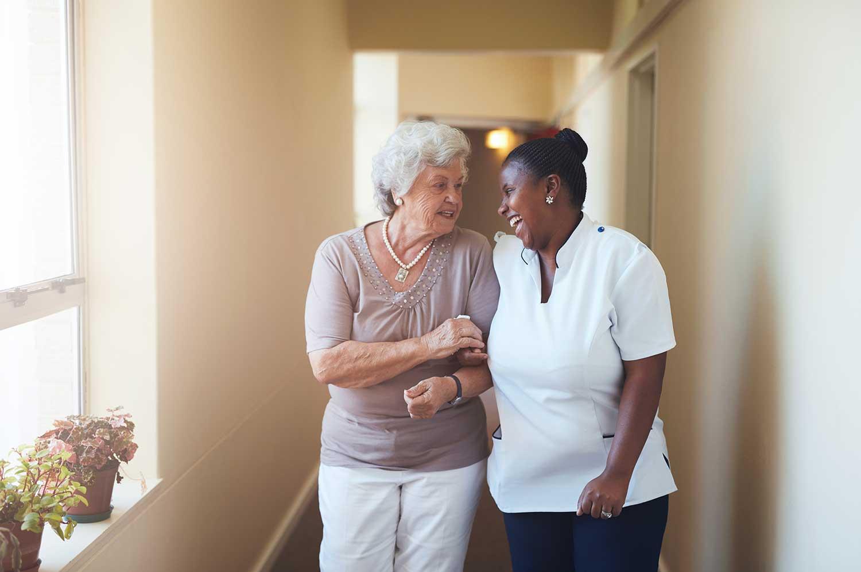Nurse Walking with Woman